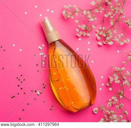 Suntan Oil On A Pink Background. Uniform Tan. A Bottle Of Suntan Oil . Protection Of The Skin. Vacat