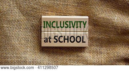 Inclusivity At School Symbol. Wooden Blocks With Words 'inclusivity At School' On Beautiful Canvas B