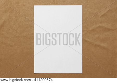 Template Of White Paper Lies On Light Brown Cloth Background. Concept Of Business Plan And Strategy.