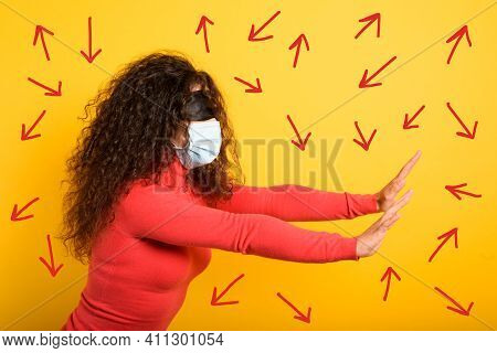 Woman With Mask And Blindfold Has Difficulty To Find The Right Way. Concept Of Uncertainty. Yellow B