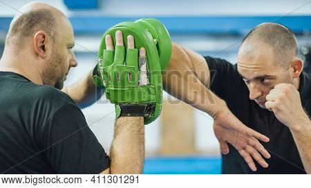 Elbow Kick Technique Training With Focus Mitts. Elbow Strike And Punch