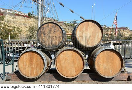 DANA POINT, CA - NOVEMBER 4, 2016: Kegs lashed with rope on the dock in front of the Pilgrim tall ship at the Orange County Ocean Institute in Dana Point, California.