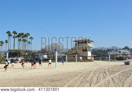 DANA POINT, CA - DECEMBER 1, 2017: Doheny State Beach Volleyball courts, lifeguard tower. The beach is a popular surf spot with Volleyball courts, picnic areas and campground.
