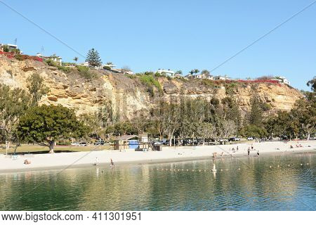 DANA POINT, CA - NOVEMBER 4, 2016: The beach at Dana Point Harbor with homes on the bluffs above.