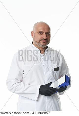 Confident Portrait On White Background Of A Handsome Male Doctor, Plastic Surgeon Wearing Black Glov