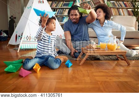 Happy family spending playtime in a relaxed atmosphere at home together. Family, together, love, playtime