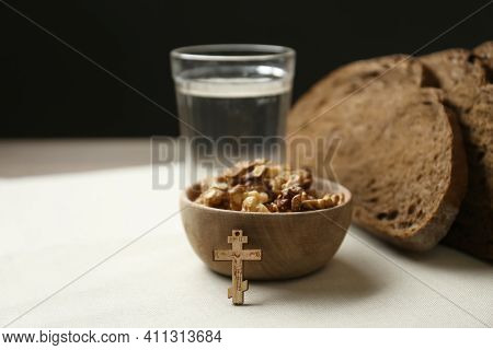 Bread, Walnuts, Water And Crucifix On Table. Great Lent Season