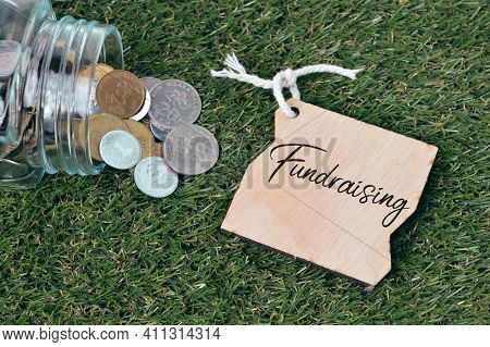 Coins And Wooden Tag Written With Fundraising.