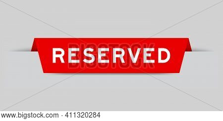 Red Color Inserted Label With Word Reserved On Gray Background