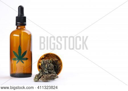Marijuana Oil Extract And Dried Leaves On White Background. Legal Sale Of Narcotic Drugs Concept