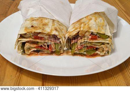 Homemade Shawarma In Thin Wheat Tortilla In White Plate.