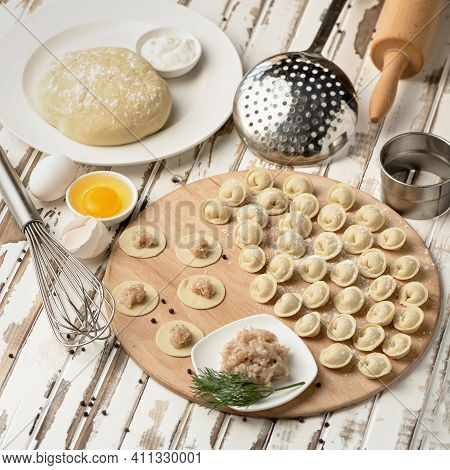 Meat Filling On Raw Dough Circles. Process Of Cooking Dumplings. Top View. Ingredients And Kitchen U