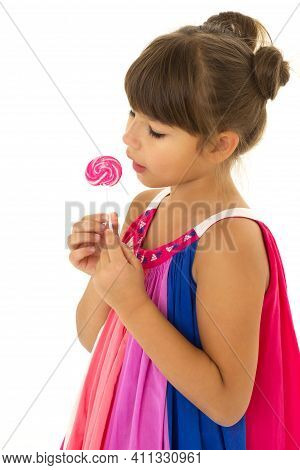 Pretty Girl Posing With Lollipops. Lovely Girl In Bright Summer Dress Posing In Studio On Isolated W