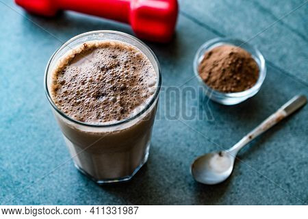 Chocolate Protein Shake Smoothie With Whey Protein Powder And Red Dumbbells. Sports Drink. Sporty Be