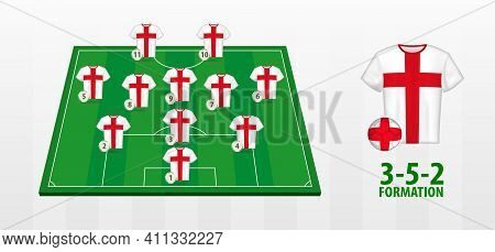 England National Football Team Formation On Football Field. Half Green Field With Soccer Jerseys Of