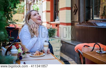 A Woman Of Plus Size, American Or European Appearance Walks At City Streets Enjoying Life. A Young L