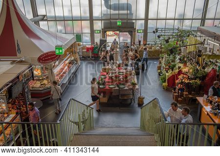 Stands And Customers In The Historic Market Hall, Kleinmarkthalle, Frankfurt Am Main Germany.