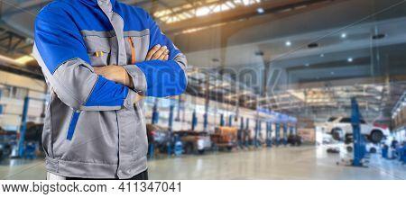 Auto Mechanic In The Auto Service Center Car