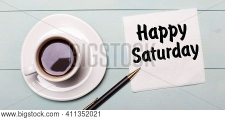 On A Light Blue Wooden Tray, There Is A White Cup Of Coffee, A Handle And A Napkin That Says Happy S
