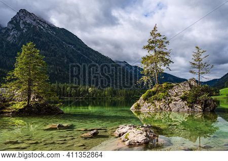Lake Hintersee With Rock And Trees In The Berchtesgaden Alps, Germany.