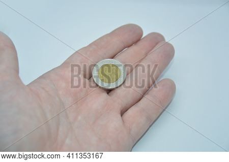 Metal Coins Of The Bank Of Egypt In The Hand Of A The Man