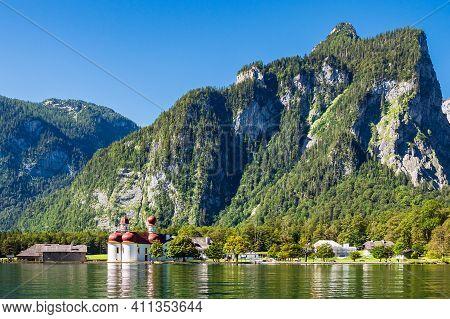 Lake Koenigssee With Pilgrimage Church Saint Bartolomew In The Berchtesgaden Alps, Germany.