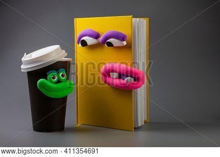 Animated book and coffee cup with eyes and mouth. Cartoon plasticine parts of face on things. Dialogues of things
