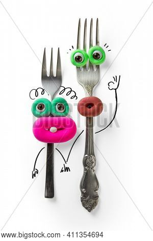 Animated fork with eyes and mouth. Cartoon plasticine parts of face on things with drawn elements