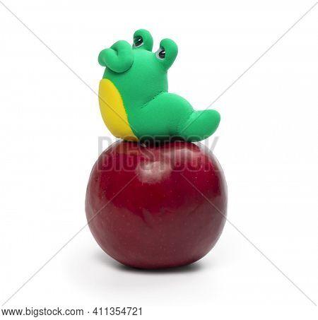 Plasticine worm on the apple isolated on the white background. Plasticine hero