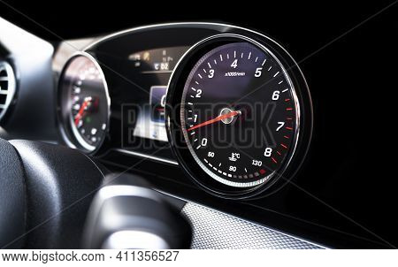 Close Up Shot Of A Speedometer In A Car. Car Dashboard. Dashboard Details With Indication Lamps. Car