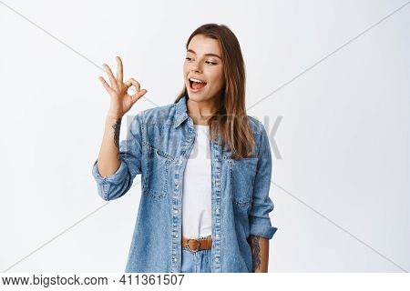 Alright. Smiling Cute Girl Showing Okay Sign And Say Yes, Approve Something Good, Like And Agree, St
