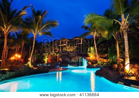 Tropical Resort Pool at Sunset in Hawaii