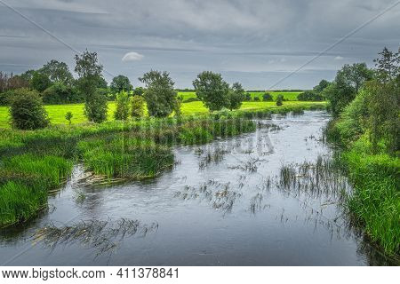 Green Agriculture Fields And Meadows With A Forest On Riverbank Of Boyne River, Count Meath, Ireland