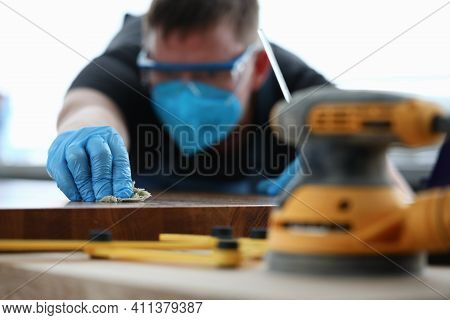 Man Covering Wooden Tabletop With Oil Closeup. Repair And Restoration Of Wooden Furniture Concept