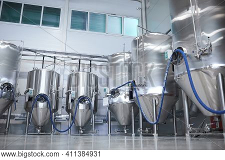 Wide Angle Background Image Of Distillery And Fermentation Tanks At Modern Industrial Brewery, Copy