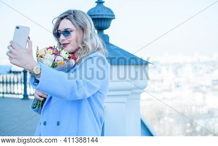 Young Stylish Woman Walking On The City Street At Spring . Casual Fashion Modern Look. Plus Size Mod