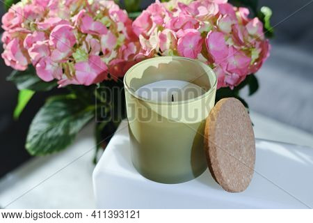 Scented Perfumed Candle And Flowers. Home Fragrances For Cozy Atmosphere. House Aromatic Soy Candle