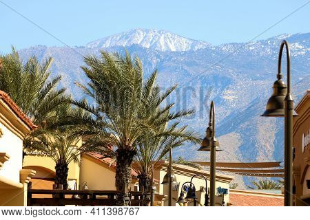 March 6, 2021 In Cabazon, Ca:  Modern Buildings With Retail Stores Besides Palm Trees Taken At The D