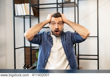 American Shocked Businessman Receiving Unexpected News, Touching His Head With Round Eyes, Being Sur