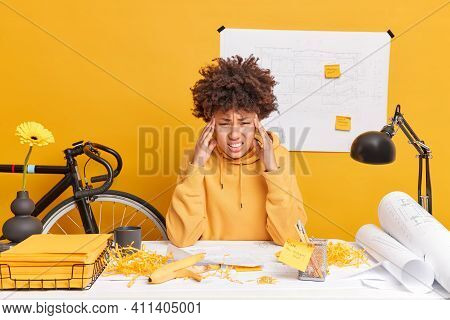 Frustrated Exhausted Afro American Woman Touches Temples Suffers From Severe Headache Tired Of Worki