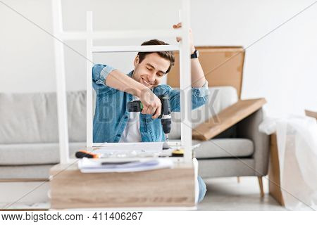 Work At Home, Joiner Is Fixing Table, Renovation In Flat And New Desk. Happy Millennial Attractive M