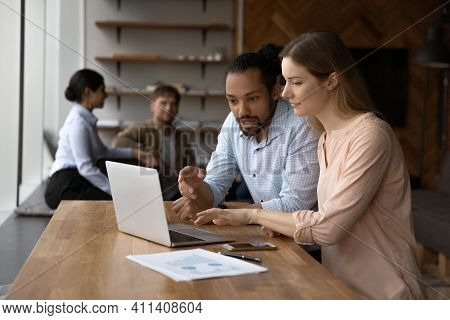 African American Businessman Training Intern, Pointing At Laptop Screen