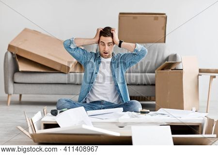Human Emotions, Problems With Furniture Assembly And Difficult Repairs. Shocked And Scared Young Guy