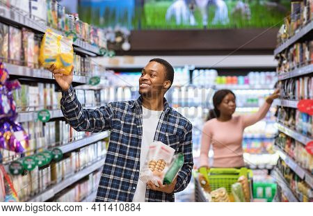 Grocery Shopping. African American Couple Buying Products At Supermarket, Copy Space. Black Man And