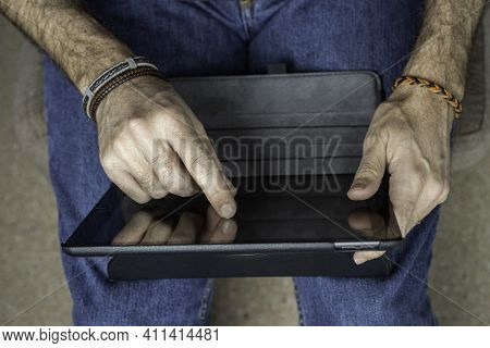 Man Working With A Tablet From Home Conceptual Remote Work, Telecommuting, Technology