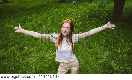 Self Care, Mental Wellbeing, Mental Health, Mindfulness. Young Red-haired Woman Enjoying Life In Nat
