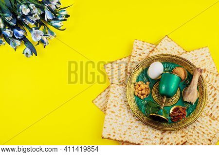 Jewish Matzah Bread With Silver Cup And Flowers On Wooden Rustic Background. Passover Holiday Concep