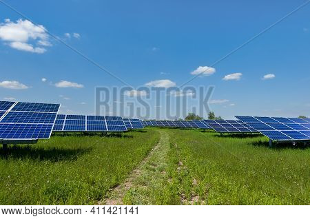 Solar Panels On The Sky Background. Solar Power Plant. Blue Solar Panels. Alternative Source Of Elec
