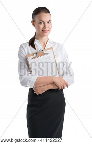 Office Woman In White Shirt And Black Skirt, Holding Business Files Smiling, Looking At The Camera.