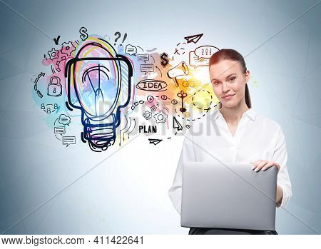 European Attractive Young Woman In Formal White Shirt Holding Laptop And Pondering Near Light Blue W